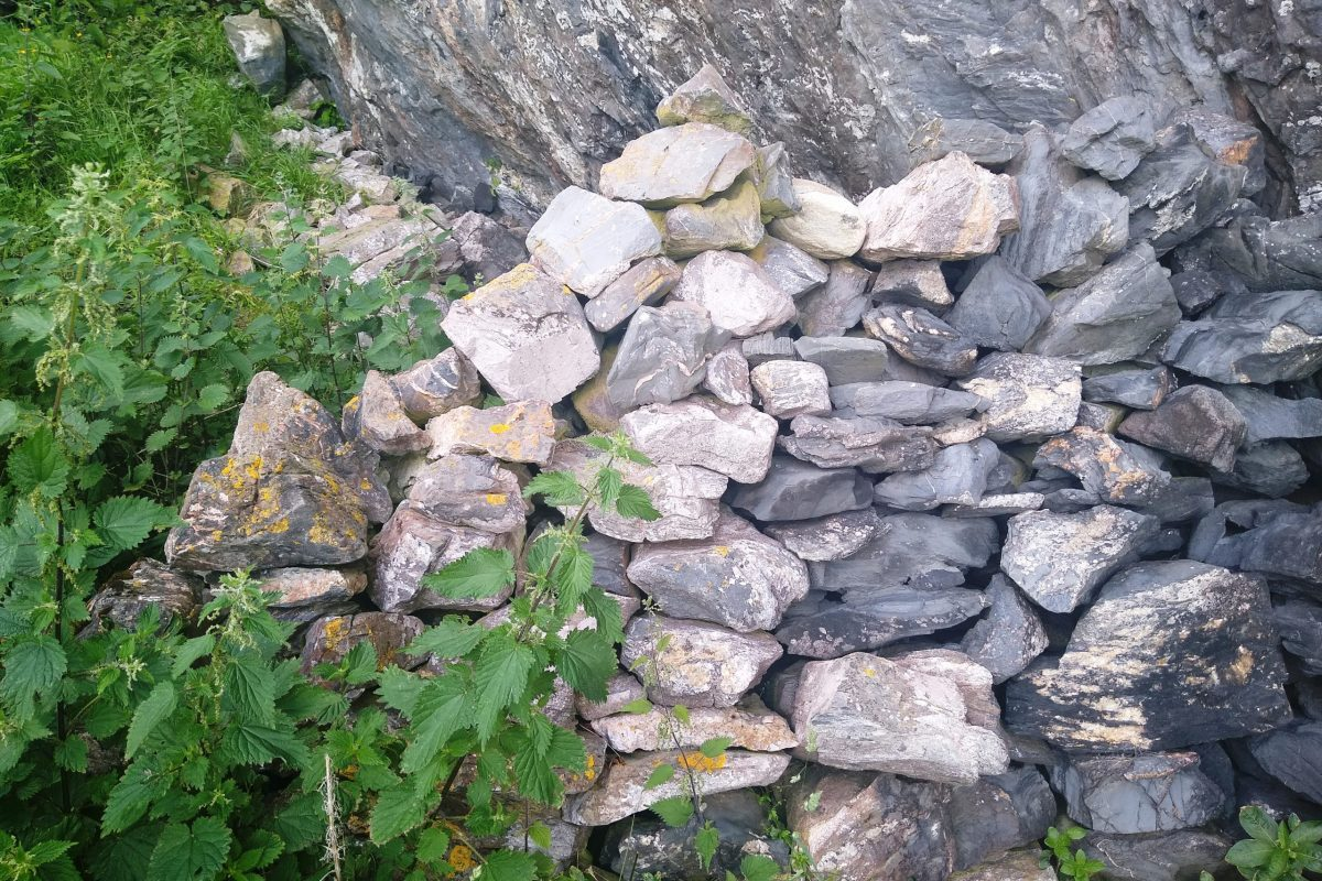 Stone wall outside cave